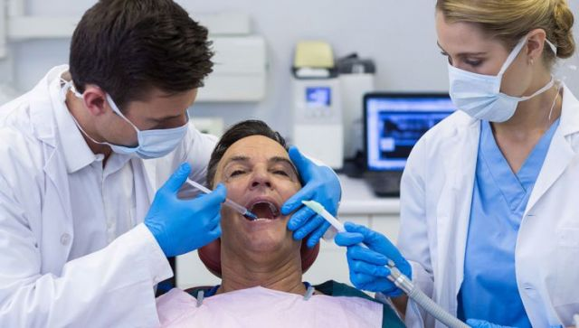 Dentist and nurse injecting anesthesia to patient - San Jose, CA 95116