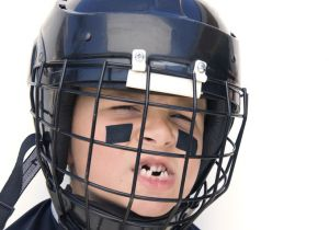 Little boy in football helmet