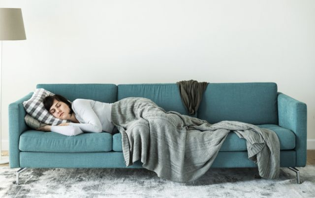 Woman resting in sofa after oral surgery - San Jose Oral Surgery, CA