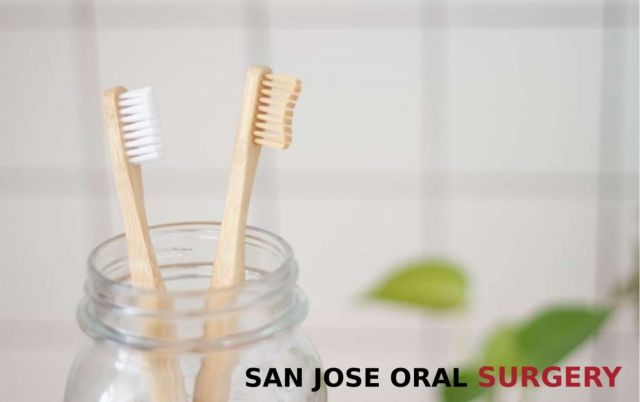 Two wood toothbrushes inside a clear glass jar - San Jose CA